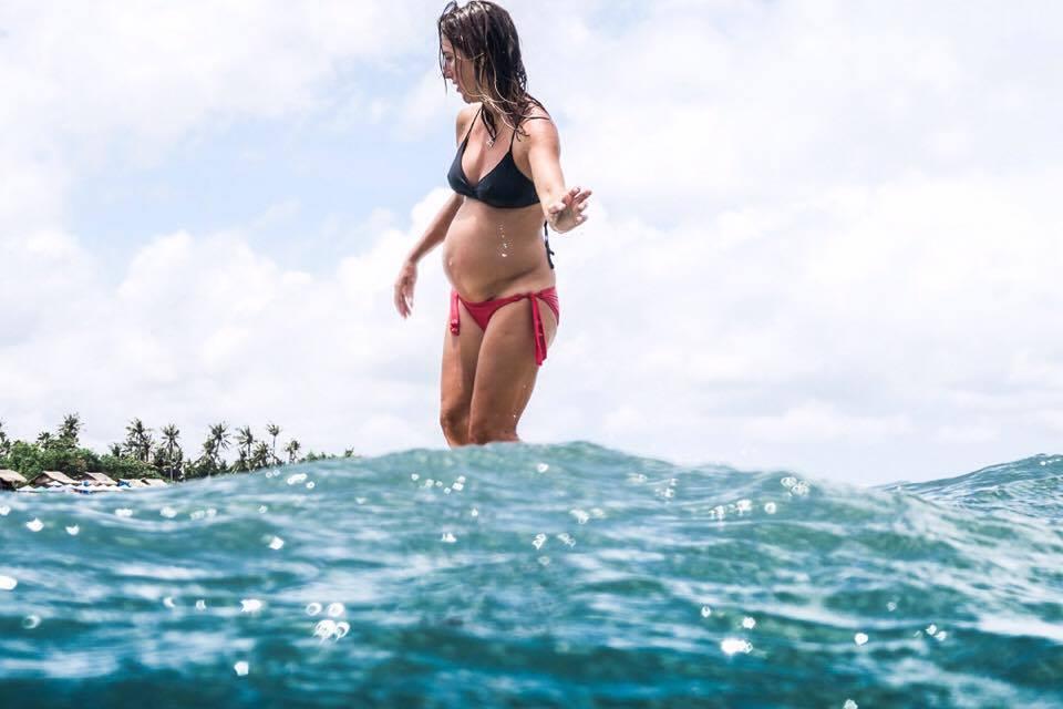 pregnant surfer