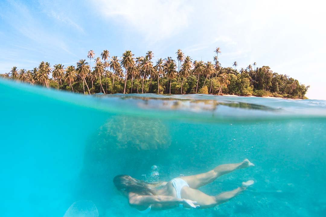 swiming in crstal clear water mentawai island